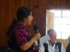 ACEBAR's Education Coordinator Manuela Addressing Graduates