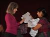 Board Member Lynn Waespi Recieving Commemorative Shirt from ACEBAR's Manuela Larios