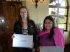 Friend of MayaCREW Katie Wikler Giving Computer to ACEBAR